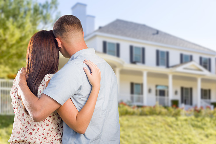 image of couple looking at nice new house