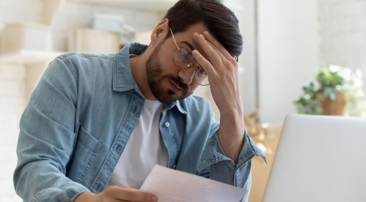 image of a man stressed about bills