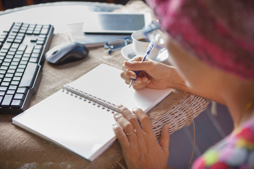 image of woman writing in a checklist